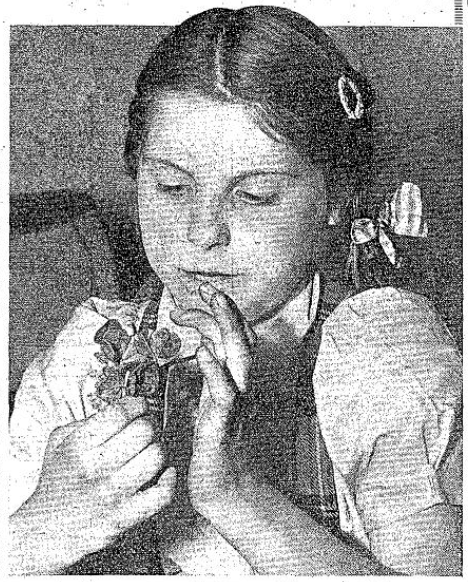 Joan Nott and four-leaf clovers - Daily Express (London, England) - 14 May 1953